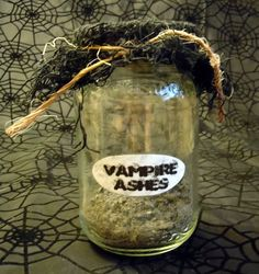 Vampire Ashes Jar... could make several & label them with the names of infamous vampires. A trophy collection for a vampire slayer. Maybe do a bookcase with those, a vampire slaying kit, etc.