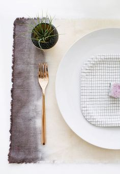 There are several different ways to go about DIY ombre wedding details, but one of the easier methods involves dip dyeing. This technique is great for creating subtle ombre placemats for a boho themed wedding table.