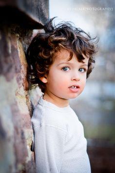 Looks like a mini Ian Somerhalder. Too cute!
