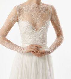 Rosa Clará 2012 Bridal Collection--definitely too low cut for me--but look at how fine that lace is!