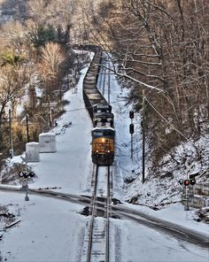 A unit train heads west back to coal mines of West Virginia on a snow-covered day on CSX's New River Subdivision at Kanawha Falls, W.Va.