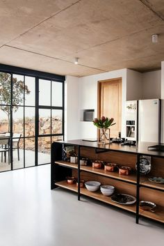 Industrial Style Architect's House created by Nadine Engelbrecht in South Africa using a barn as inspiration Stunning wooden island acts as a central hub of the kitchen space Industrial Kitchen Design, Interior Design Kitchen, Industrial Style, Kitchen Decor, Kitchen Ideas, Kitchen Supplies, Kitchen Counter Design, Minimal Kitchen Design, Industrial Windows