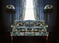 All wallpaper in one print? Dark library room with sofas upholstered same as walls?