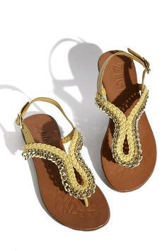 Yellow sandals with chain trim