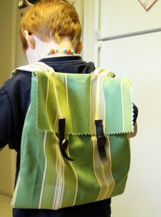 Upholstery Sample backpack - great way to use up upholstery samples. Also a great first hand sewing project for kids