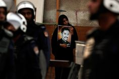 Hasan Jamali—AP  April 14, 2012. An anti-government protester holds a picture of jailed opposition human rights activist Abdulhadi al-Khawaja during a demonstration outside the British Embassy in Manama, Bahrain.