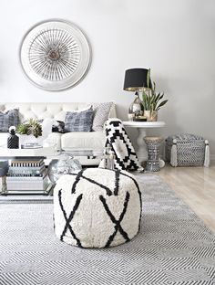 blue and neutral eclectic boho living room with black and white accents