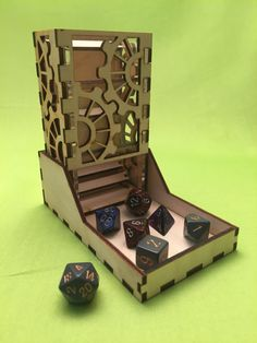 These dice towers stand approximately 5 tall and are composed of two pieces. The first piece being the tower which is two layers of high quality materials. The inner layer, which holds the wooden dice randomizing baffles, is made of a cast acrylic substrate. Depending on the tower the acrylic may be clear, opaque, or semi-opaque. Surrounding that acrylic on the tower is 3mm birch plywood. The plywood has been cut into a design to showcase the acrylic underneath. The second component of this…
