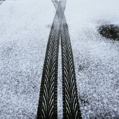 tyre tracks in the road over a dusting of snow
