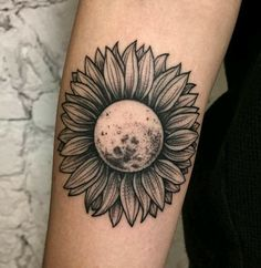 Moon or earth with gerber daisy...
