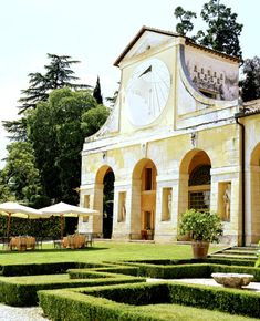 Sunny color scheme and legant garden at Palladian Villa, Barbaro. Note the area behind the sundial feature is actually a dovecote use to raise doves for food and use waste for fertilizer.