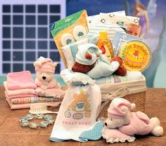 """""""Sweet Dreams Baby New Baby  Basket =   A Sweet Dreams Sleeping Teddy Bear with a pillow rattle delivers the Sweet Dreams Baby New Baby Basket. This fabric lined baby storage hamper carries baby grooming items, a first hand print kit, a sweet baby picture frame, and lots of good wishes for sweet dreams for baby! Send the Sweet Dreams Baby New Baby Basket to new arrivals of your family and friends.  WWW.LEEANNA.LABELLABASKETS.COM #WeGiveBack #LeeannasLaBellaBaskets #giftstore #giftshop…"""