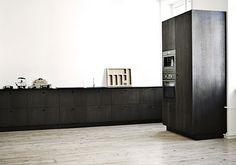 The dark kitchen in smoked oak