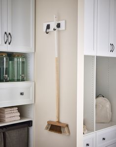 Your mudroom can have a dedicated space for everything, even the broom. Closet Storage Systems, Custom Closets, Storage Cabinets, Mudroom, Home Organization, Master Suite, Hooks, Entryway, Flooring