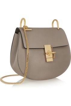 Gray textured-leather (Lamb) and suede (Calf) Pin and clasp-fastening front flap Designer color: Motty Gray  Comes with dust bag Weighs approximately 2.2lbs/ 1kg