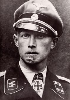 """The Face Of War - Christian Tyschen.  Christian joined the SS in December 1931 and was assigned to 50 Standarte. Ten months later he transferred to SSVT. He became a company leader of 'Germania' in October 1936 until December 1938 when he was promoted to be a batallion commander.  He was a Battalion Commander of """"Der Führer"""" Regiment, part of the 2nd SS Panzer Grenadier Division """"Das Reich"""".in Russia in 1942 when he took a hit from a shell which shattered his jawbone. He spent many months…"""