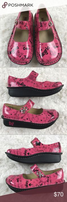 """NWOB Alegria Paloma Clog Pink Awareness Ribbon Alegria pink patent leather mary janes. Silver awareness ribbon on the strap with velcro closure. Graphic prints on the shoes. Pink butterfly on the sides of outsole. Patent leather upper and leather lining. 1.5"""" heel height. Insole length approximately 9 1/4"""". Alegria Shoes Mules & Clogs"""