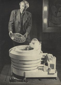 Frank Lloyd Wright with a model of the Guggenheim Museum (1945)