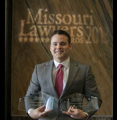Joshua P. Myers accepting his award from Missouri Lawyer's Weekly as Missouri's Winningest Trial Lawyer based upon reported verdicts and also accepting an award on behalf of his firm Schultz & Myers, LLC as one of Missouri's Winningest Law Firms.