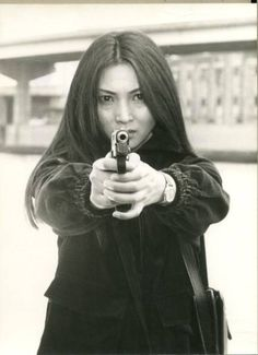 Press photo for Brilliant Detective (華麗なる刑事), 1977, starring Meiko Kaji (梶芽衣子).http://fuckyeahmeikokaji.tumblr.com