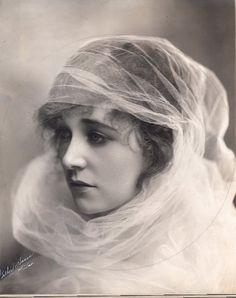 Edwardian lady with organza veil