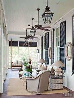 classic style: neutral furnishings + black shutters, mix of lanterns and ceiling fans