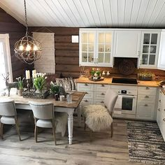 I like this of cabinet and modern style. Also all the different textures. Rustic Kitchen, Kitchen Dining, Kitchen Decor, Cabin Homes, Log Homes, Cabin Design, House Design, Log Home Interiors, Log Home Kitchens
