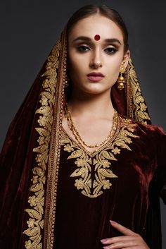 From our Bridal Heritage Collection, this is a burgundy silk velvet lehenga outfit adorned with exotic Kashmiri Gold Tilla embroidery on lehenga, shirt and dupatta. Designer Dress For Men, Indian Designer Outfits, Indian Outfits, Designer Dresses, Embroidery Suits Punjabi, Embroidery Dress, Indian Dress Up, Pakistani Wedding Outfits, Pakistani Bridal