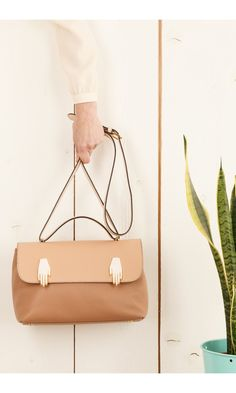 Bag with two hands by Jordan Grace Owens