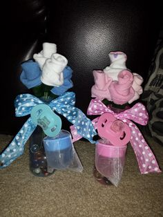 These beautiful sock bouquets are perfect as a gift or center piece! Each rose is hand created to most closely resemble a rose. -Includes 3 pair of socks, 1 bottle, 1 pacifier -Bottles weighed down with glass rocks/beads -Color/Pattern options depend on availability -Customization