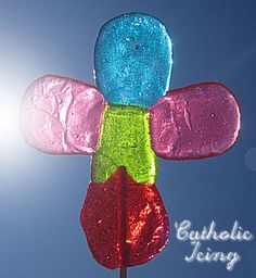 Jolly Rancher Pops - Put 1 candy on foil in 225F oven for 1-2 minutes, then add more candies to form and cross and bake for 5-6 min until melted. Insert lollipop sticks or wooden skewers.