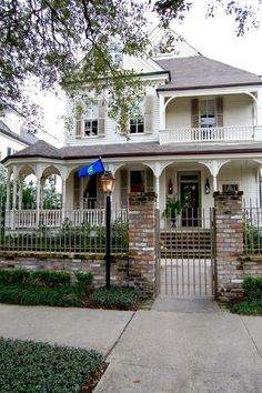 Much like the city of New Orleans itself, this 1800s Victorian home has a historic and traditional exterior, but a vibrant charm radiates behind the doors.  Exterior paint: Spring in Aspen; shutter paint: Brandon Beige, both by Benjamin Moore