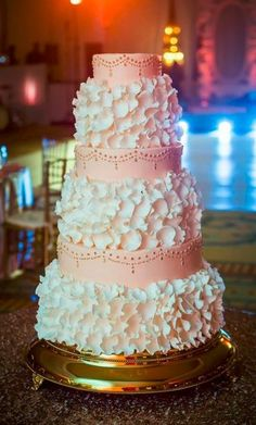Handcrafted white petals and delicate gold piping make for a stunning accent to any wedding cake at The Ritz-Carlton, Amelia Island.