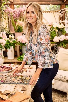Lauren Conrad in an LC Lauren Conrad for Kohl's Floral Flutter Blouse and Skinny Jeans