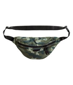 Waist bag in woven fabric with a two-way zip at the front, a zipped outer compartment at the back and two inner compartments. Adjustable waist strap with a
