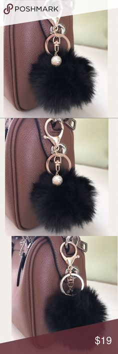 HOTSale pom pom key chain ❤️❤️Black Pom Pom keychain great for winter warm cozy soft road trips shopping night out vacation traveling cruises after work attire hot ladies shirt trending popular Jewelry