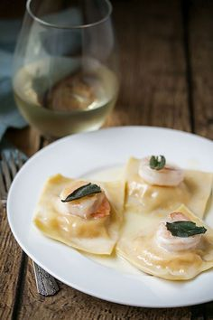 Fresh butternut squash ravioli with mascarpone cheese, drizzled in a buttery truffle sauce and topped with a pan fried prawn and crispy sage.