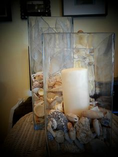 Use left over shells from the beach to line glass candle holders