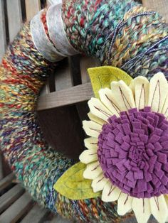 yarn wreath gone wild.. Love looking at yarns n textures but don't care to crochet or knit but this way I could make something I would use. Love the seudo sunflower!