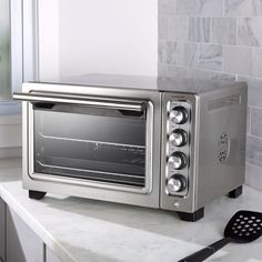 Sale ends soon. Enjoy full-size oven performance in a counter-sized oven. Bake pizza, toast bread, broil a side dish or keep food warm with this convenient convection toaster oven from Kitchenaid. Small Appliances, Kitchen Appliances, Kitchen Gadgets, Stainless Steel Toaster, Keep Food Warm, Safety Valve, Pizza Bake, Cooking Utensils, Wall Oven