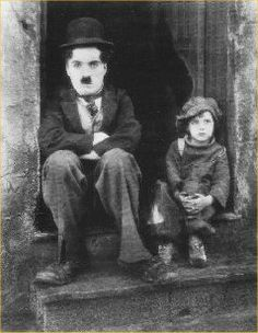 Charlie Chaplin.   The Kid.