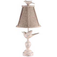 A handsome antique white bird accent lamp with a linen shade.