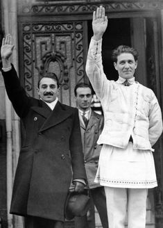 """Capitanul"": The founder of the Romanian ""Iron Guard"", Corneliu Codreanu (right), is wearing a national costume on April 21, 1938, in front of his party headquarters in Bucharest. A few days later, King Carol II banned the party and arrested Codreanu. On November 30 of the same year, the fascist leader was killed during an alleged escape attempt. Ukraine, The Third Reich, Axis Powers, Bucharest, Interesting History, St Michael, Great Photos, World War Ii, Japan"