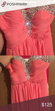 Formal dress, sweat heart neckline. I bought two dresses for my senior prom but ended up wearing the other one that I got so this one still has the original tags. The dress is more of a coral or watermelon pink but is absolutely stunning. It also has a little bit of a train. Open to responsible offers. Dresses Prom