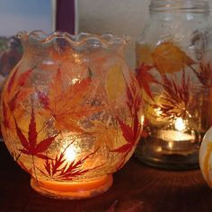 Fallen Leaf Lanterns are easy mason jar crafts for kids that look absolutely stunning. Use any kind of recycled glass container you have for these fall crafts for kids.