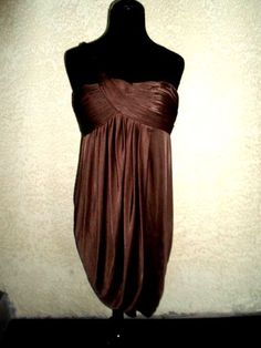 BCBG Max Azria Women's Dress Size 10 NWT  this beautiful dress has a pleated style pattern on top; Dress has a draping style on the bottom; Dress has a slant adjustable strap style; Dress has a zipper on the back.Ebay item #161090293800 sale price $59.99