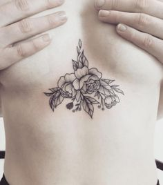 We've given you two lists featuring female chest tattoos, sideboob tattoos, and underboob tattoos; we really thought that we had covered all of the bases. Then a brilliant idea hit us, sternum tatt...