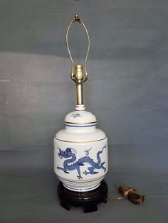 This is a gorgeous Chinese Ginger Jar table lamp. It is blue and white and decorated with a great dragon design. size estimate : table lamp tall, a ginger jar is tall x wide. Jar Lamp, Ginger Jars, Porcelain Lamp, Blue And White, Vintage Table Lamp, China Porcelain, Jar Table Lamp, Porcelain, Porcelain Dolls