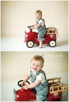 Little boy with a fire truck