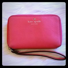 Kate Spade Cherry Lane Wallet Small wallet in a pretty pink color!  Inside pouch can fit folded bills or a smaller phone. Storage also include credit card slots and an outside zipper coin pouch. Gently used....no marks or stains. kate spade Bags Wallets